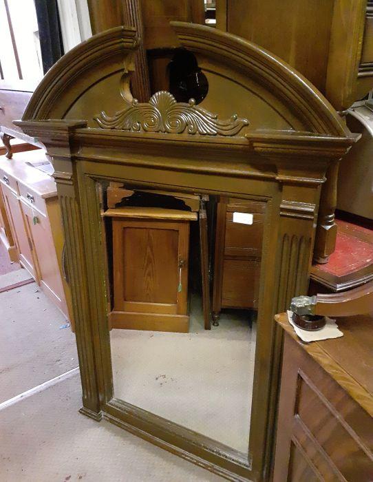 large pedimented mirror